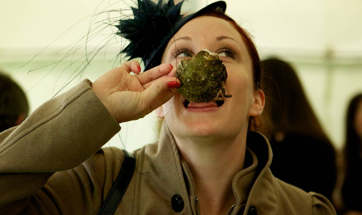 Woman eating Galway Oysters